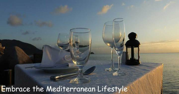 Mediterranean lifestyle dining at sunset overlooking beach