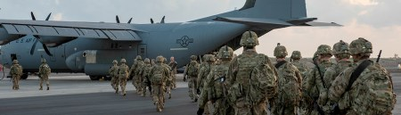 Texas Military Preparedness Commission   Office of the Texas     Military Troops Loading onto C 130 at Dyess Air Force Base in Texas