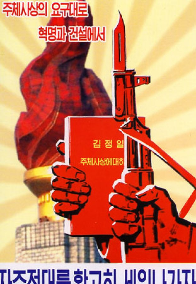 with the gun and the book of KIM IL SUNG