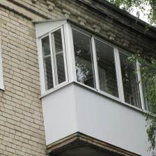 Балкон с крышей обшитый панелями