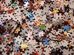 muddled box of jigsaw pieces