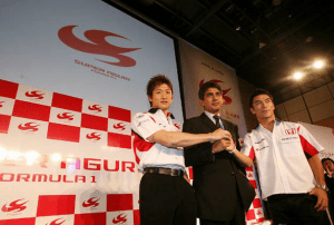 Aguri Suzuki poses with drivers Takuma Sato (right) and Yuji Ide (left) in Tokyo in March 2006.