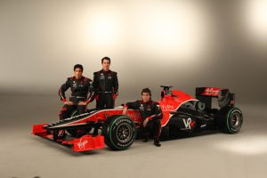 The Virgin VR-01 launch. Di Grassi (l) poses with team-mate Timo Glock (c) and test driver Luiz Razia (r).