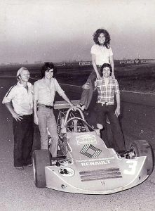 Guerra (right) posing with his Formula 2 car circa 1976.
