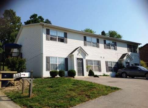 White fourplex on Dutch Valley Drive in Knoxville, Tenn.