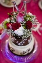 My Wedding Cakes by For Heaven's Cake - I designed the mini-cakes for each table FHC made nine and I topped with the flower arrangments
