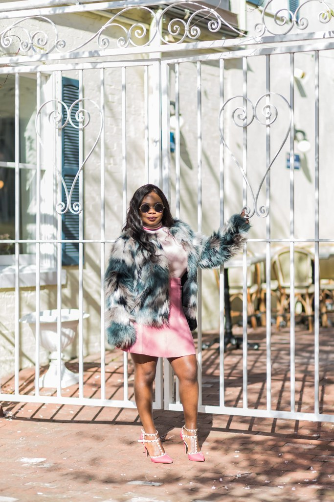 Girl wearing Multicolor faux fur coat, pink studded pumps and pastel skirt