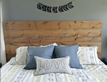 This simple DIY wooden headboard comes with easy directions that anyone can follow to make your bedroom nice and cozy!
