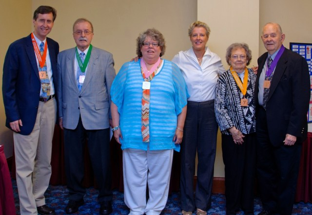 Bonnie Spann gave some of her swimming medals to GFI leaders