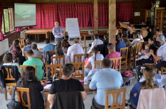 Peter leading a conference in Romania