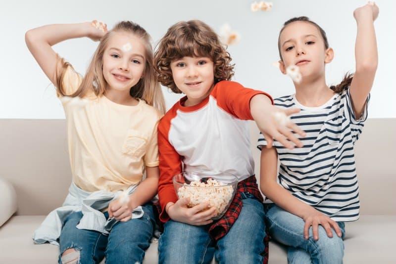 kids throwing popcorn