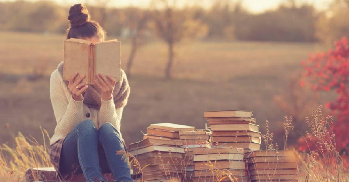girl reading books outside