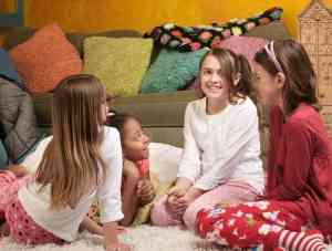 Four excited little girls together for a sleepover party