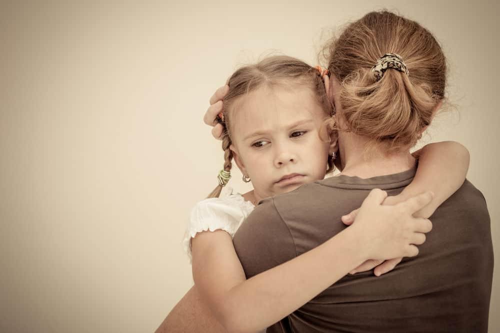 sad daughter hugging mom