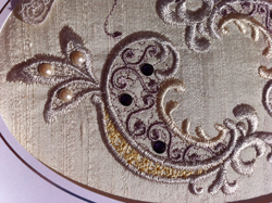 Detail of added pearls to lace