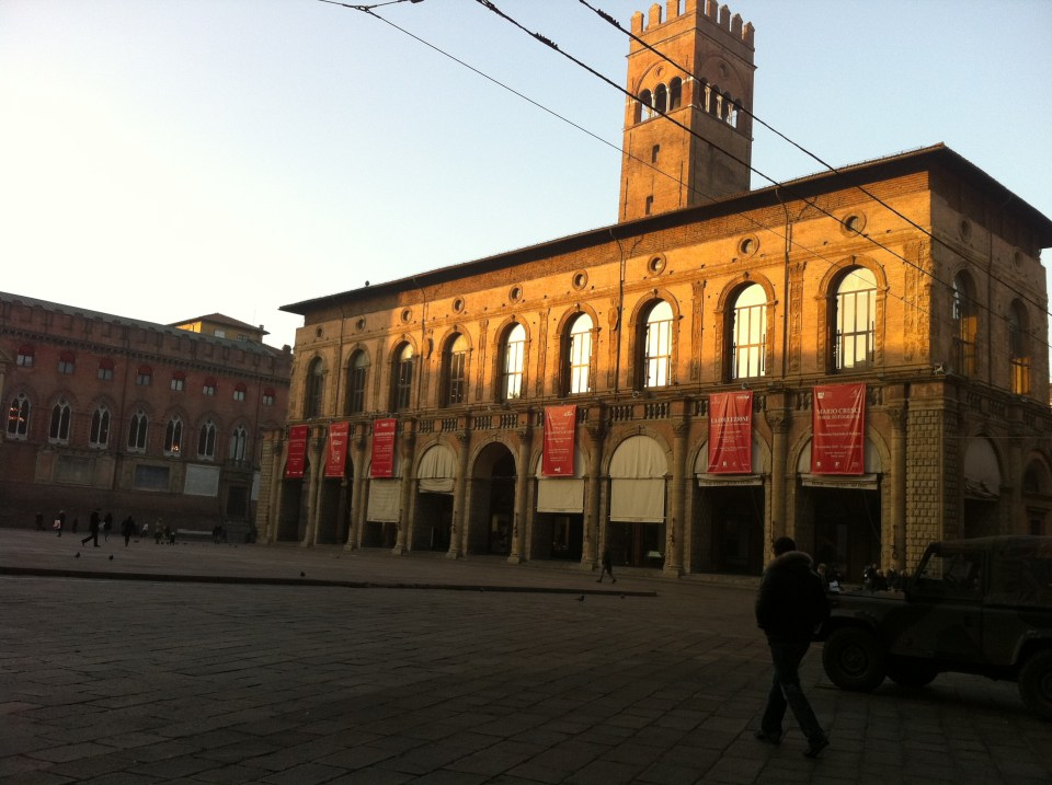 Late afternoon sun in Piazza Maggiore.
