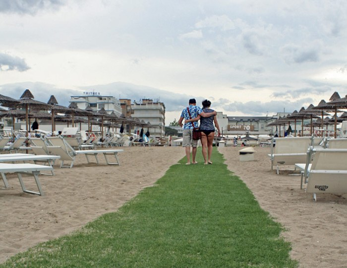 Couple on the beach in Cervia, Italy