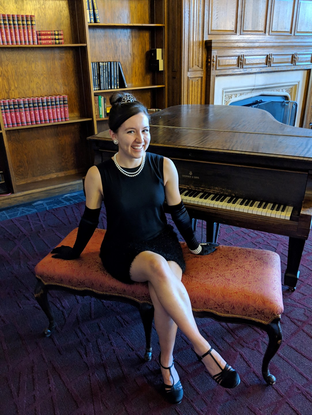 Fancy black dress and a girl sitting at a piano