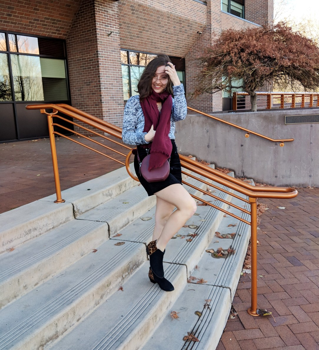 cozy winter outfit with burgundy accessories