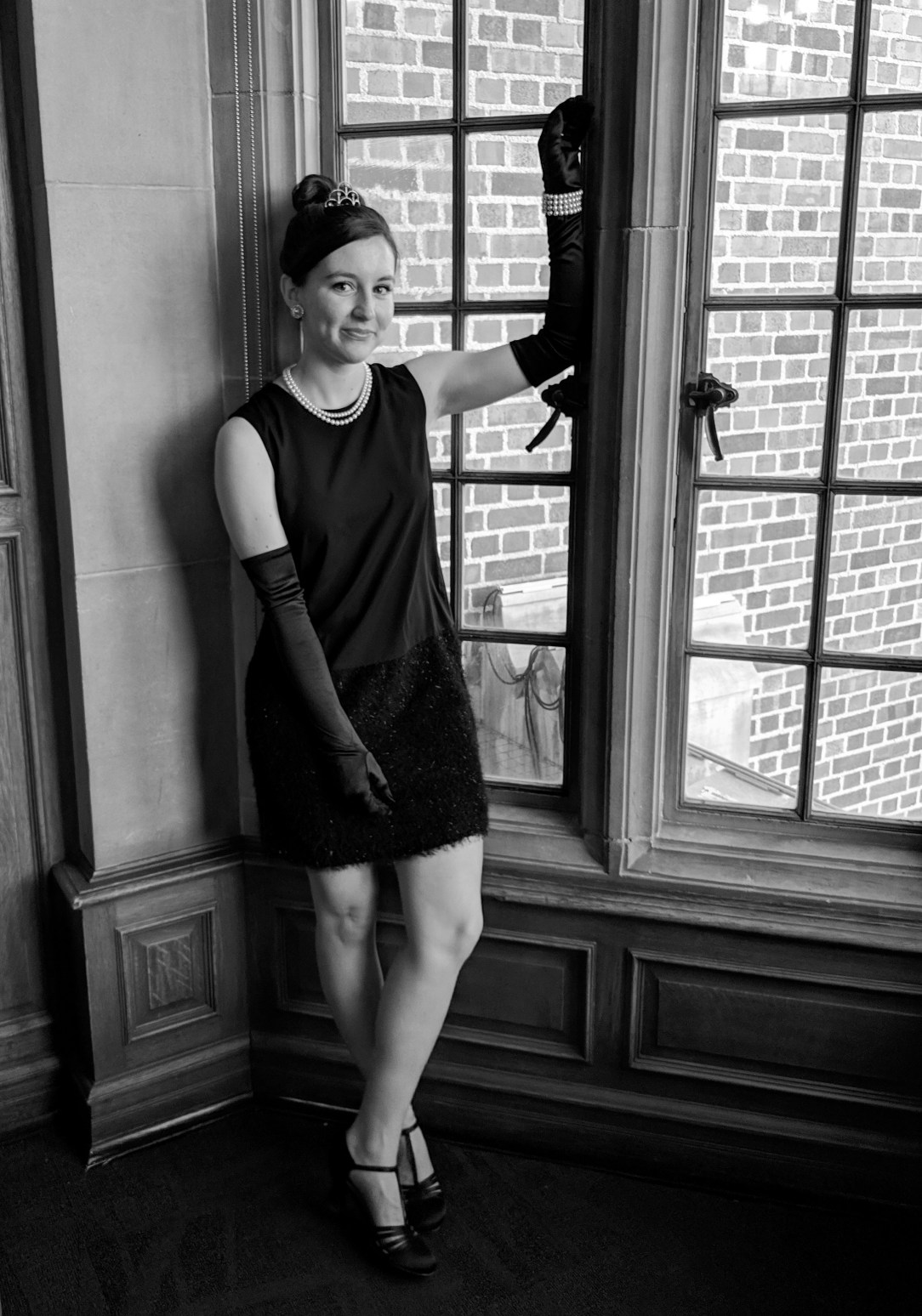 Audrey Hepburn costume leaning against a window