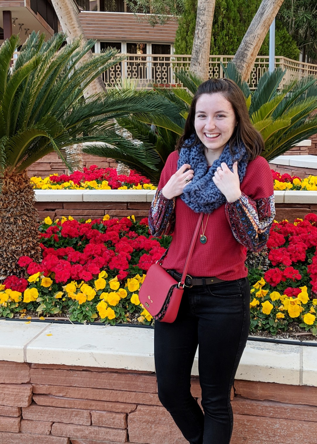 red patterned blouse blue infinity scarf