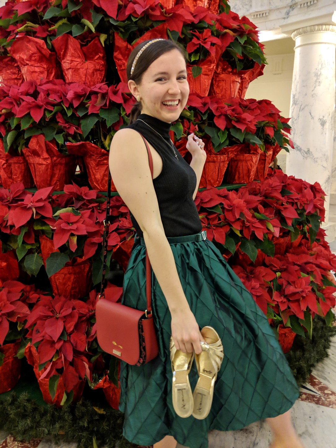 red purse holiday outfit green and black