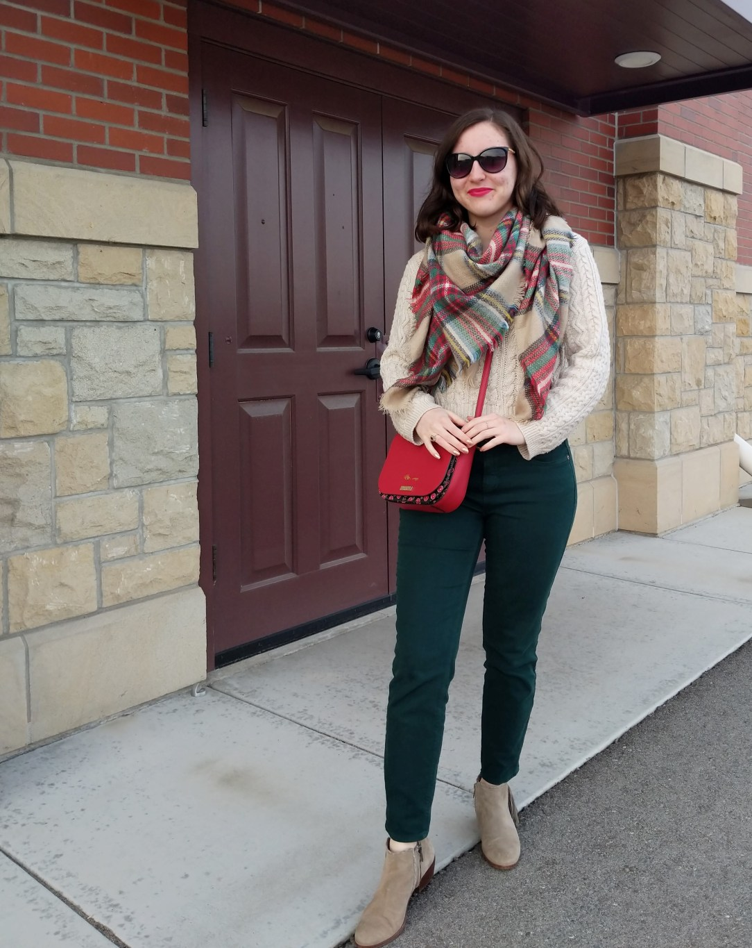 green pants red purse plaid blanket scarf