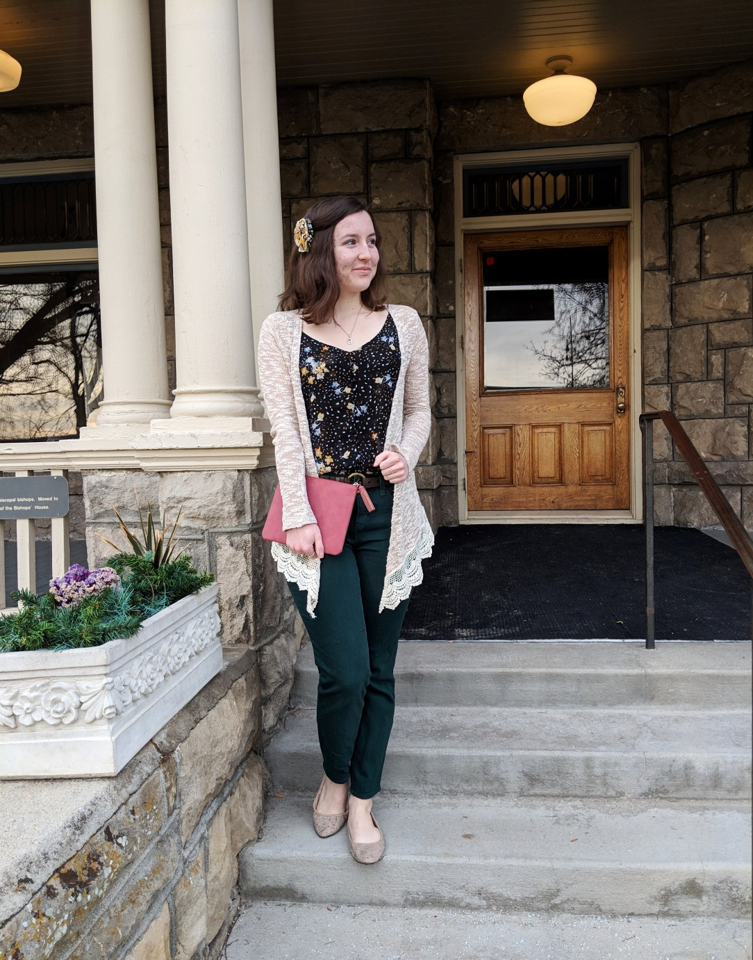 green pants with a floral tank top and beige cardigan