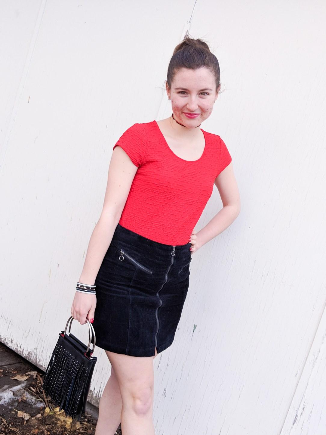 red blouse, black mini skirt
