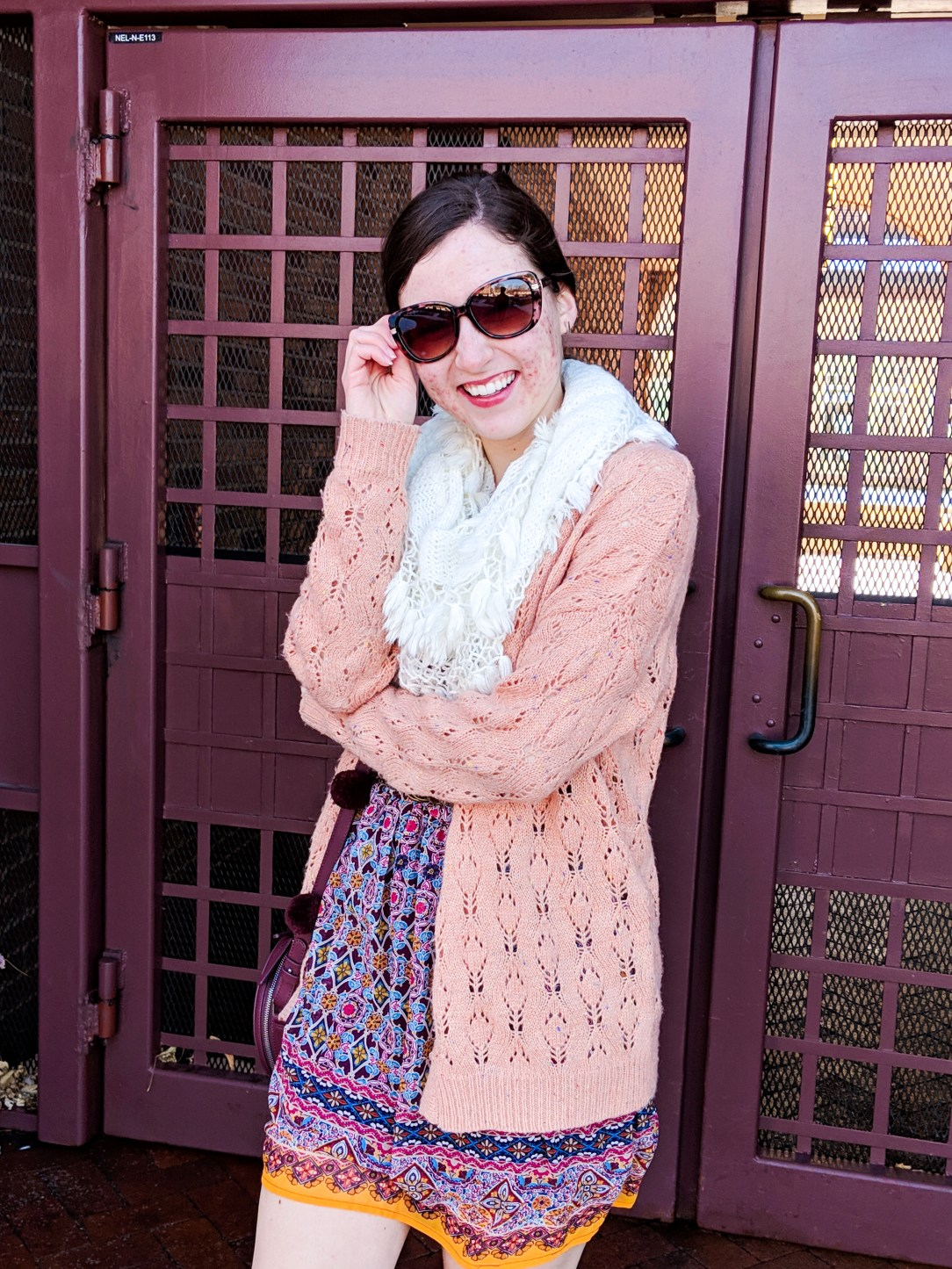 coral sweater, white infinity scarf, burgundy patterned dress
