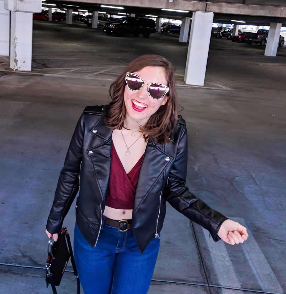 black pleather jacket and maroon vneck blouse