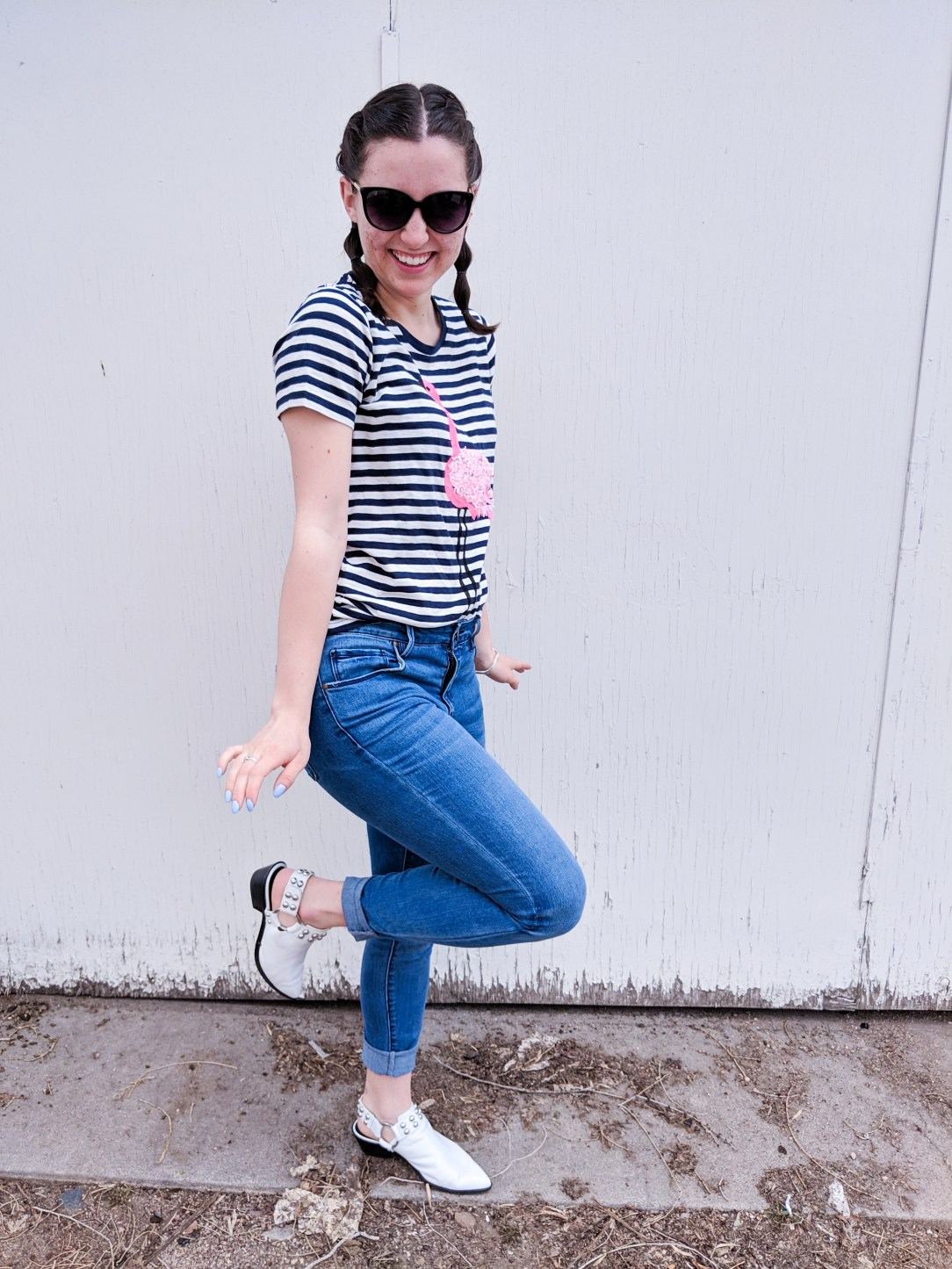 flamingo pose, striped tee, Francesca's jeans
