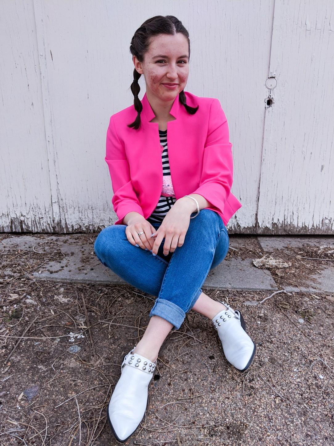 hot pink blazer, white studded mules, cuffed jeans