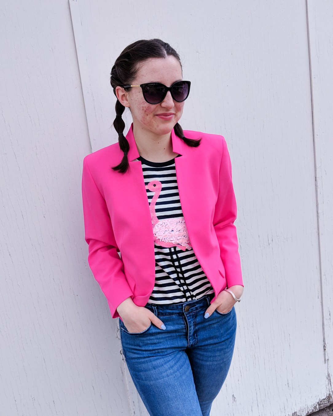 pink blazer, striped flamingo tee, jeans