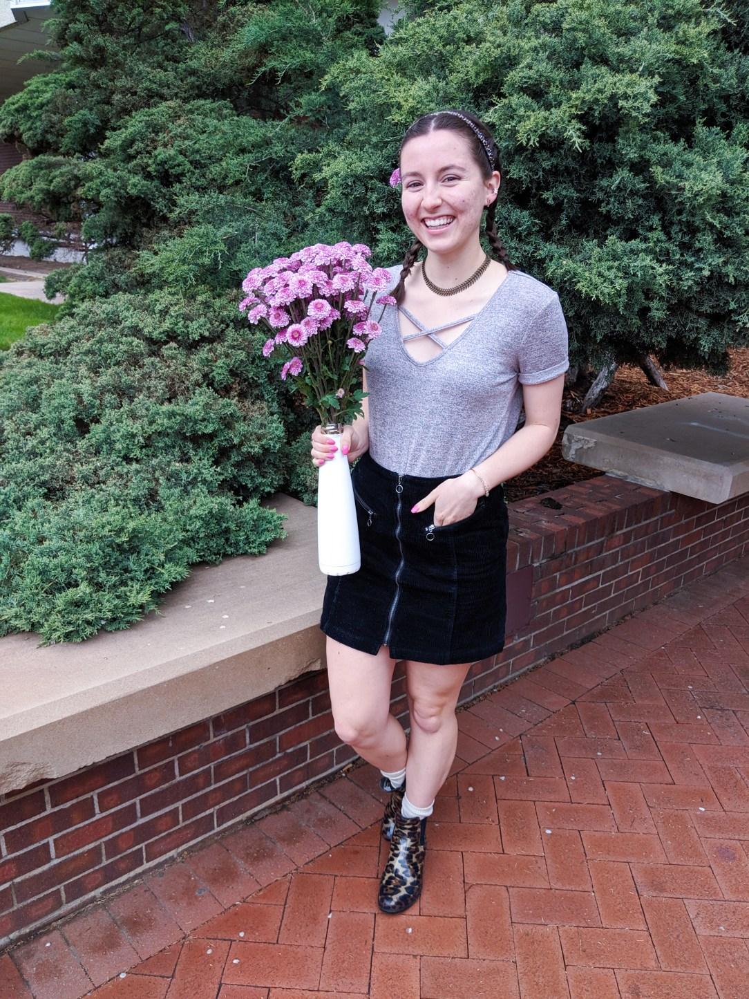 blush t-shirt, bouquet of flowers, black corduroy skirt, leopard booties