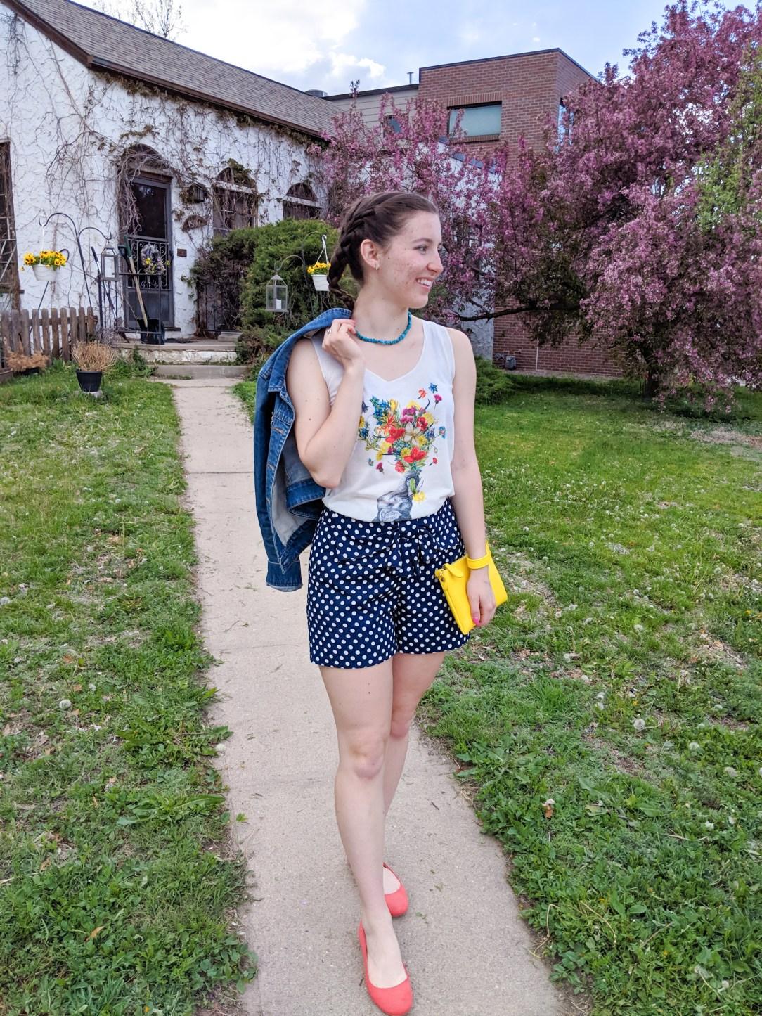floral graphic tee, yellow purse, orange flats, polka dot shorts