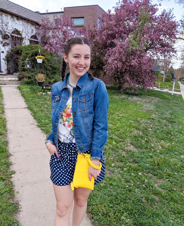 jean jacket, yellow purse, floral graphic tee, polka dot shorts