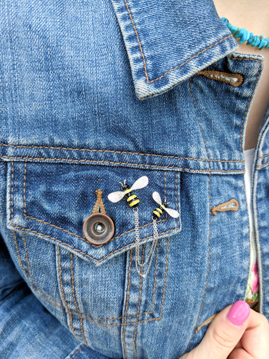 bumble bee pins, pink nail polish, turquoise necklace