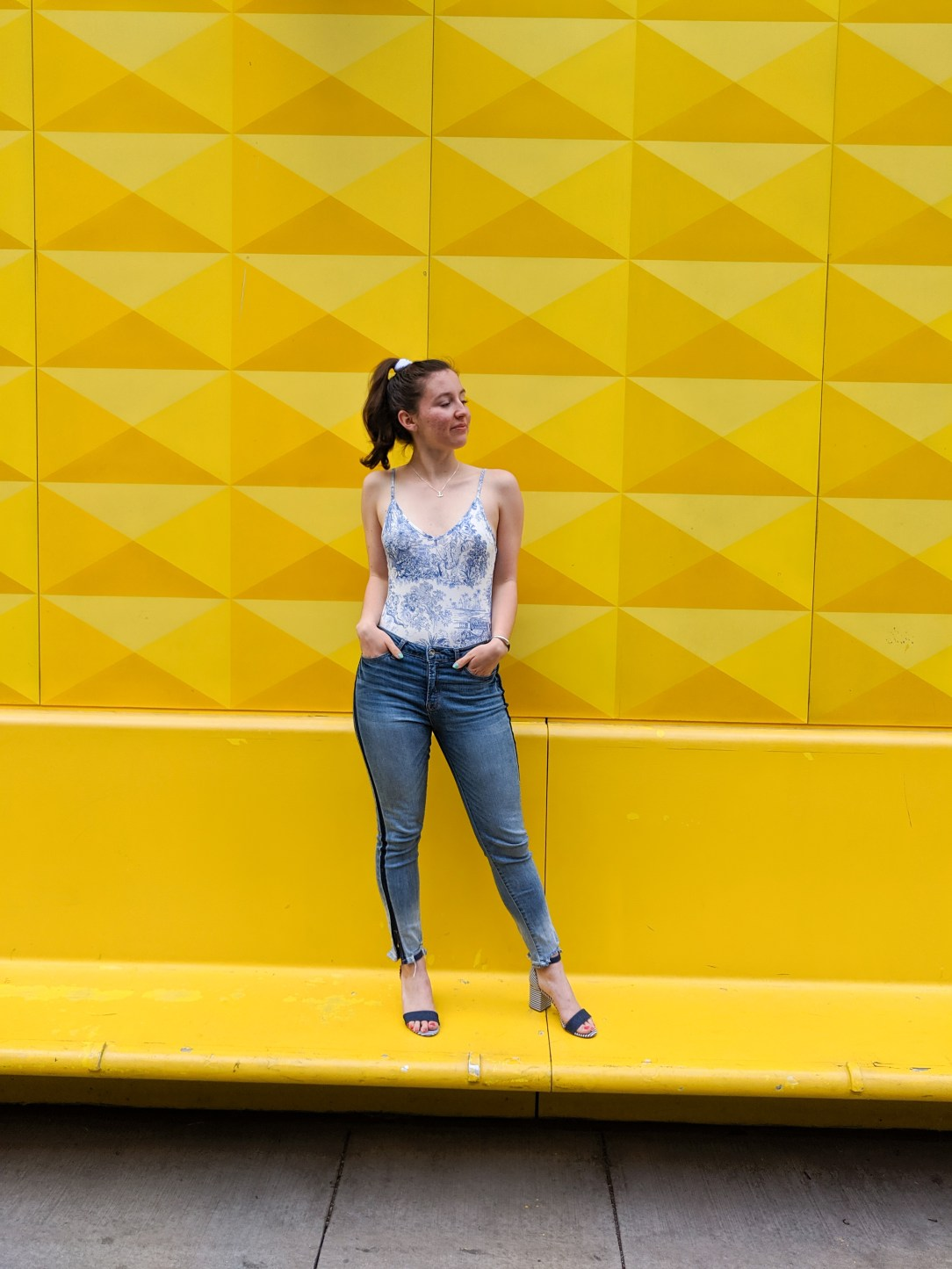 skinny jeans, bodysuit, yellow wall, downtown Denver