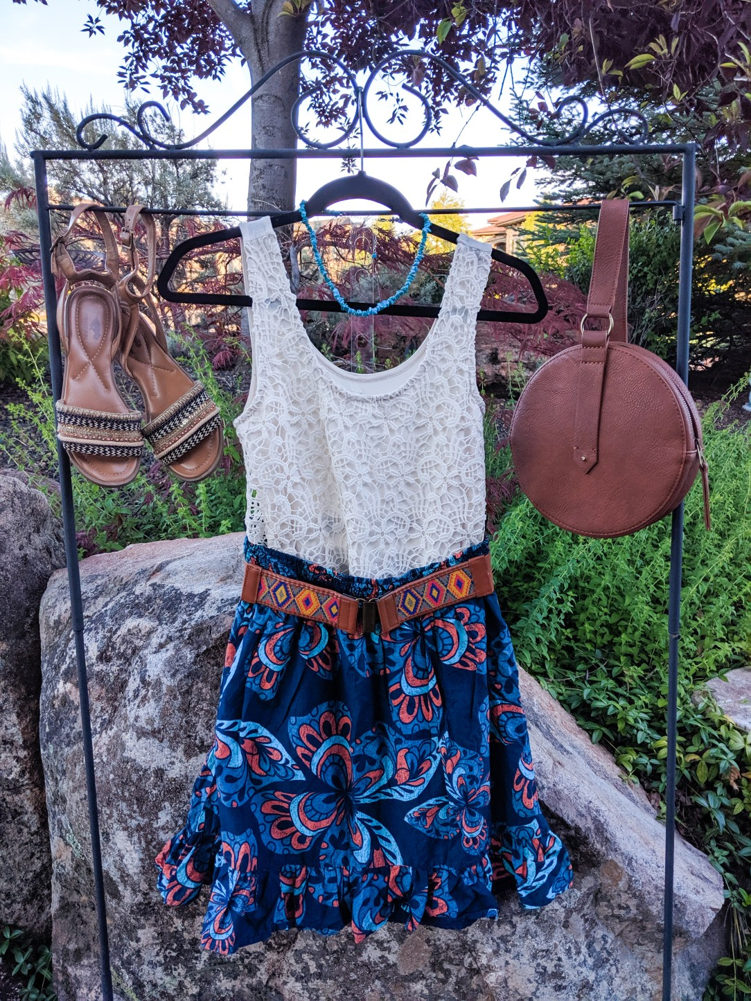 lace top, blue patterned skirt, brown accessories