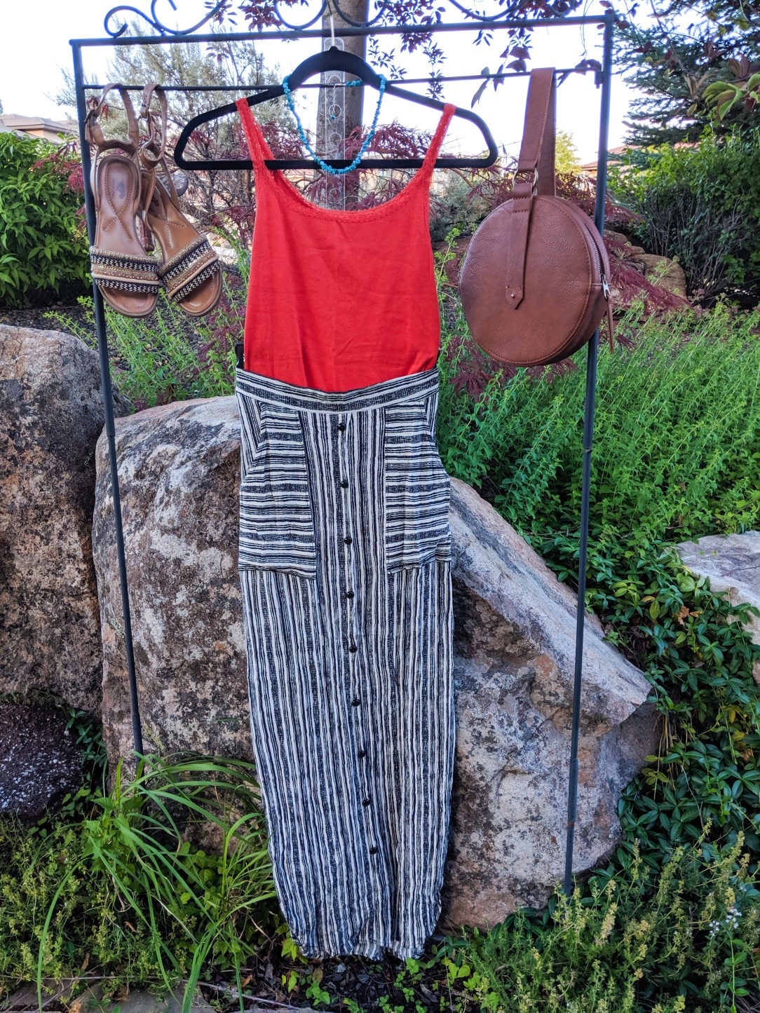 orange top, striped maxi skirt, brown accessories