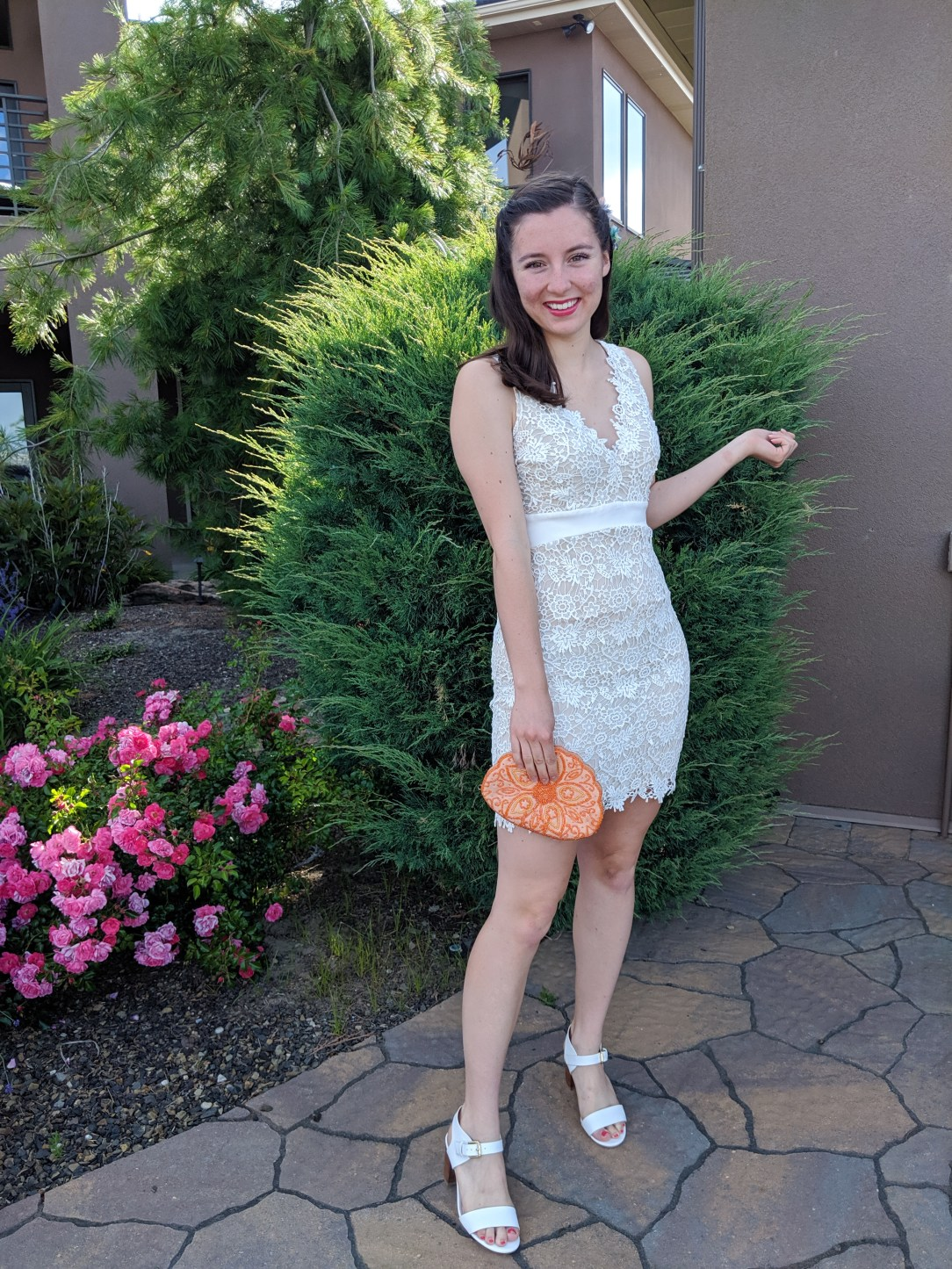 pink lipstick, orange beaded purse, how to style a white dress