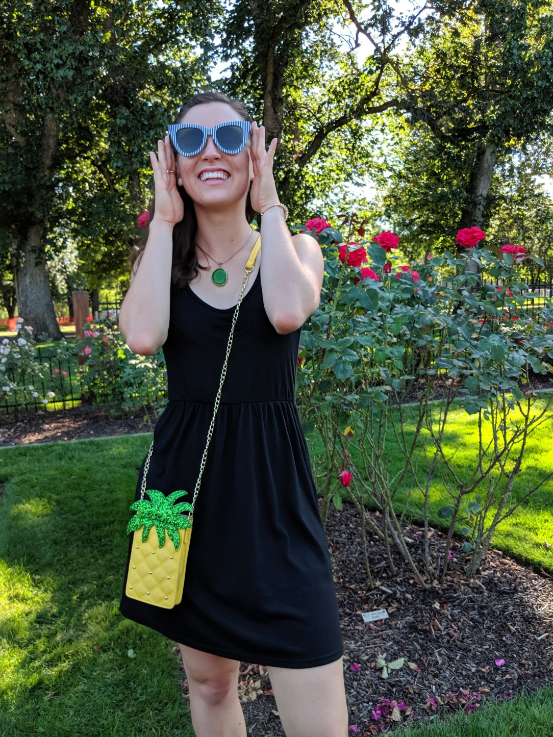pineapple purse, green necklace, black dress