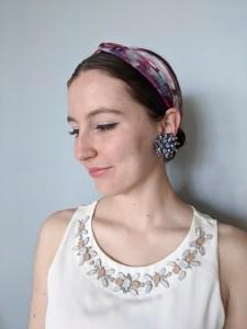 clip-on earrings, starburst earrings, hair scarf, bedazzled blouse, winged eyeliner