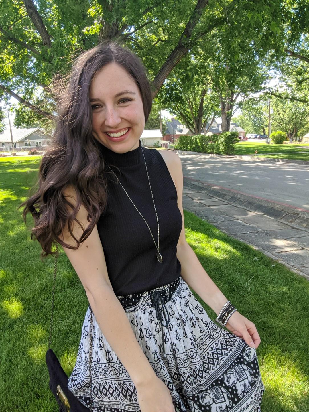black-mockneck-top-patterned-skirt-summer-outfit