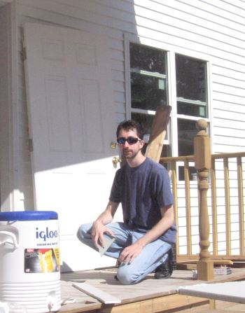 Eric cuts drywall on the front porch.