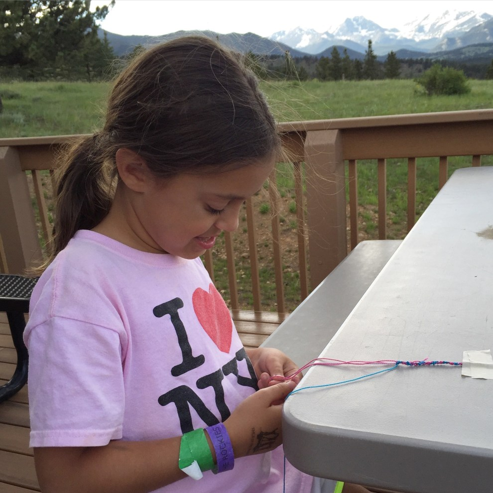 Sarah Making Friendship Bracelets at the YMCA of the Rockies
