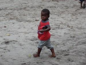 Boy walking home with his medicine.