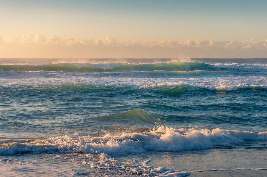 Ocean waves in the soft sunrise light.