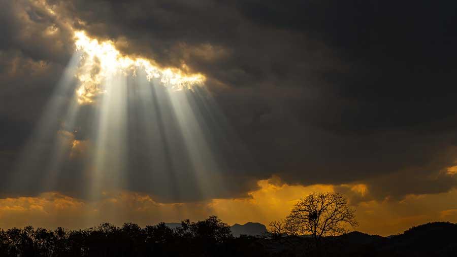 Light shines through storm clouds